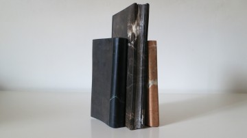 Three Standing Books